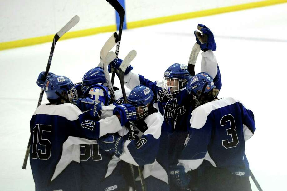 Saratoga's hockey team celebrates their 2-0 win over rival Shenendehowa during their hockey game on Thursday, Dec. 20, 2012, at the Clifton Park Arena in Clifton Park, N.Y. (Cindy Schultz / Times Union) Photo: Cindy Schultz / 00020548A