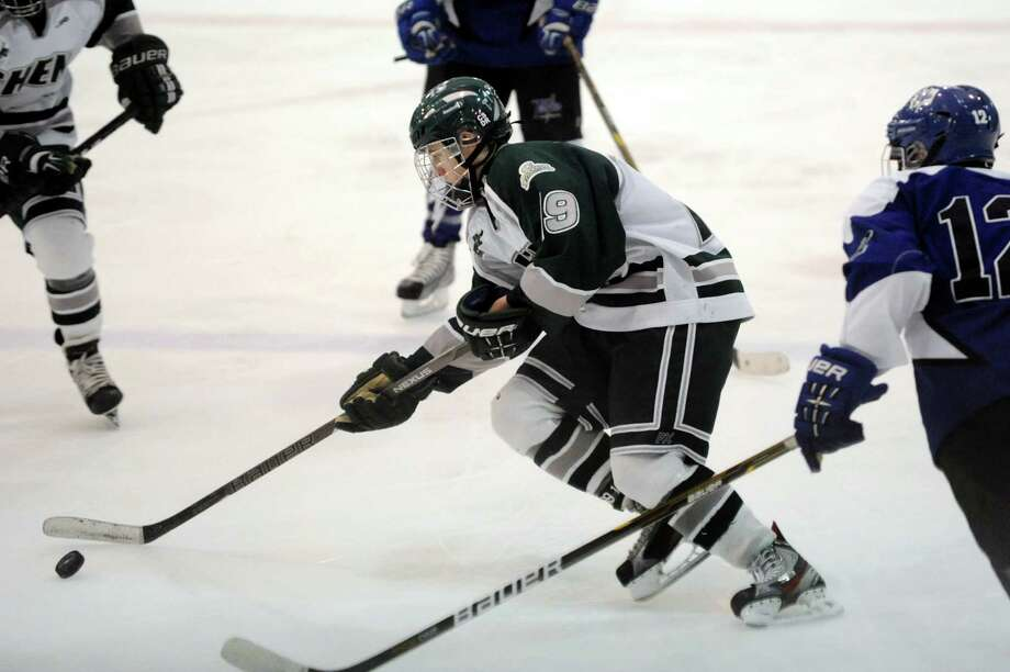Shenendehowa's Peter Russo (19), center, guides the puck during their hockey game against Saratoga on Thursday, Dec. 20, 2012, at the Clifton Park Arena in Clifton Park, N.Y. (Cindy Schultz / Times Union) Photo: Cindy Schultz / 00020548A