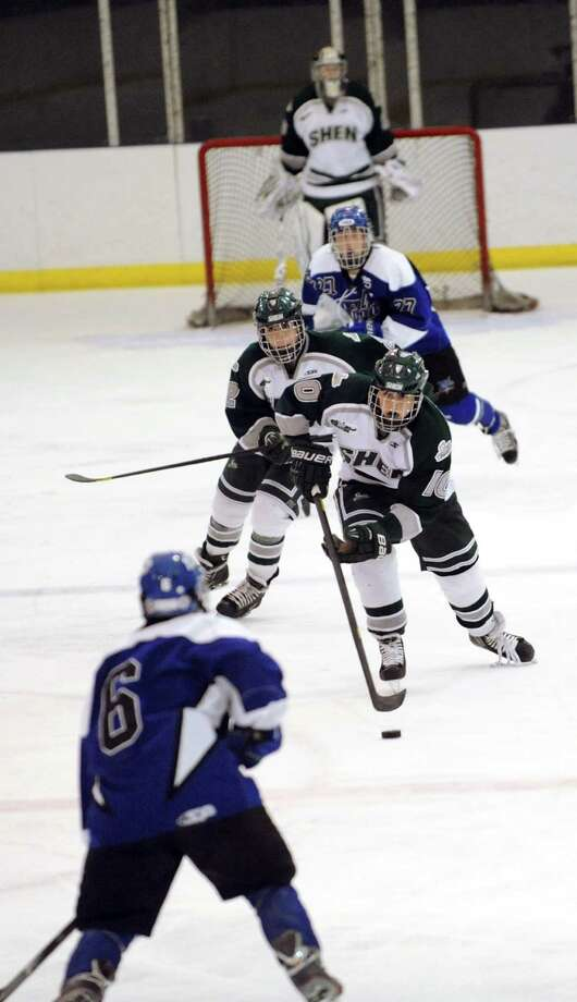Shenendehowa's Peter Sacks (10), center, leads the charge during their hockey game against Saratoga on Thursday, Dec. 20, 2012, at the Clifton Park Arena in Clifton Park, N.Y. (Cindy Schultz / Times Union) Photo: Cindy Schultz / 00020548A