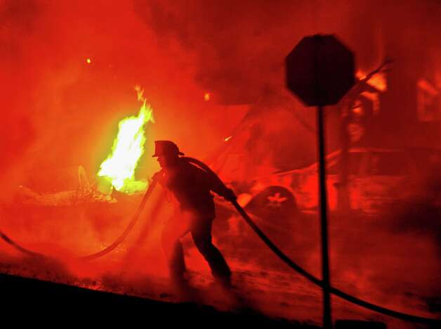 A firefighter helps battle a blaze caused by a ruptured PG&E natural-gas pipeline in San Bruno in September 2010. Photo: Noah Berger, Special To The Chronicle