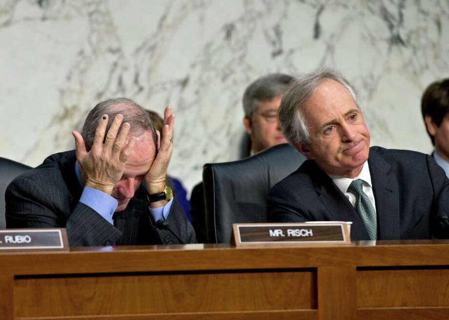 """The United States faces serious long-term debt and spending challenges that we must confront now. Sadly this deal kicks the can down the road for three months and I could not support it."" - Sen. James Risch, R-Idaho (left)Source: Idaho Statesman Photo: J. Scott Applewhite, Associated Press / AP"