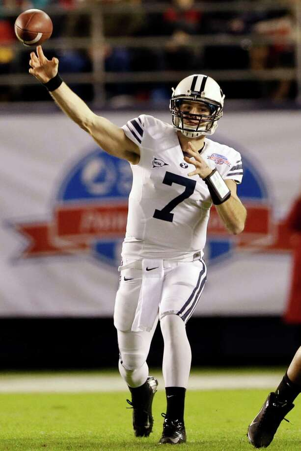 BYU quarterback James Lark throws a pass against San Diego State during the first half of the Poinsettia Bowl NCAA college football game, Thursday, Dec. 20, 2012, in San Diego. (AP Photo/Lenny Ignelzi) Photo: Lenny Ignelzi