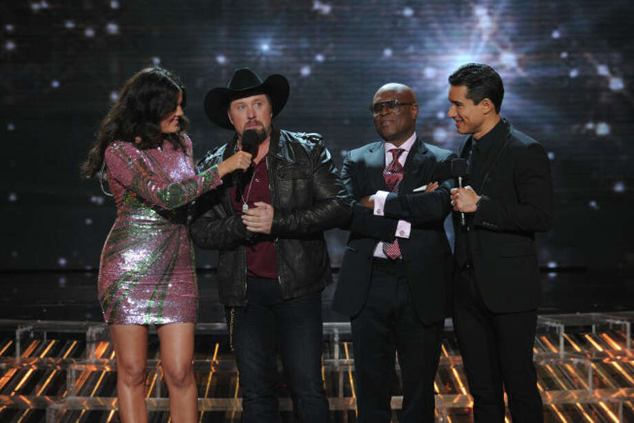 THE X FACTOR:  X FACTOR season two winner Tate Stevens, judge and mentor L.A. Reid and hosts Khloe Kardashian Odom and Mario Lopez during THE X FACTOR Finale, Thursday, Dec. 20 (8:00-9:00PM ET/PT) on FOX.  CR: Ray Mickshaw / FOX.