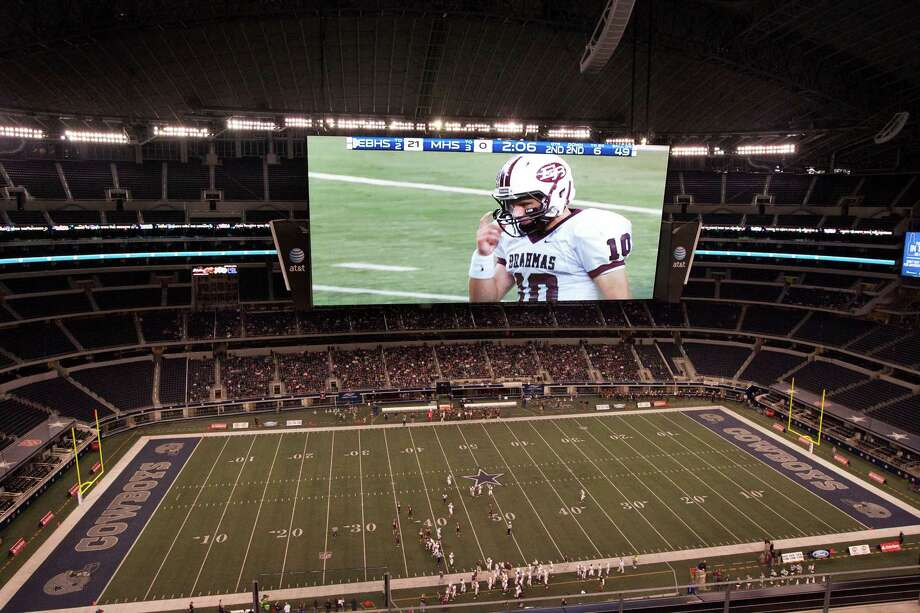 East Bernard quarterback Ty Slanina (10) is seen on the big screen during the second quarter of the Class 2A Division II state championship against Corsicana Mildred at Cowboys Stadium on Thursday, Dec. 20, 2012, in Arlington. Photo: J. Patric Schneider, For The Chronicle / © 2012 Houston Chronicle