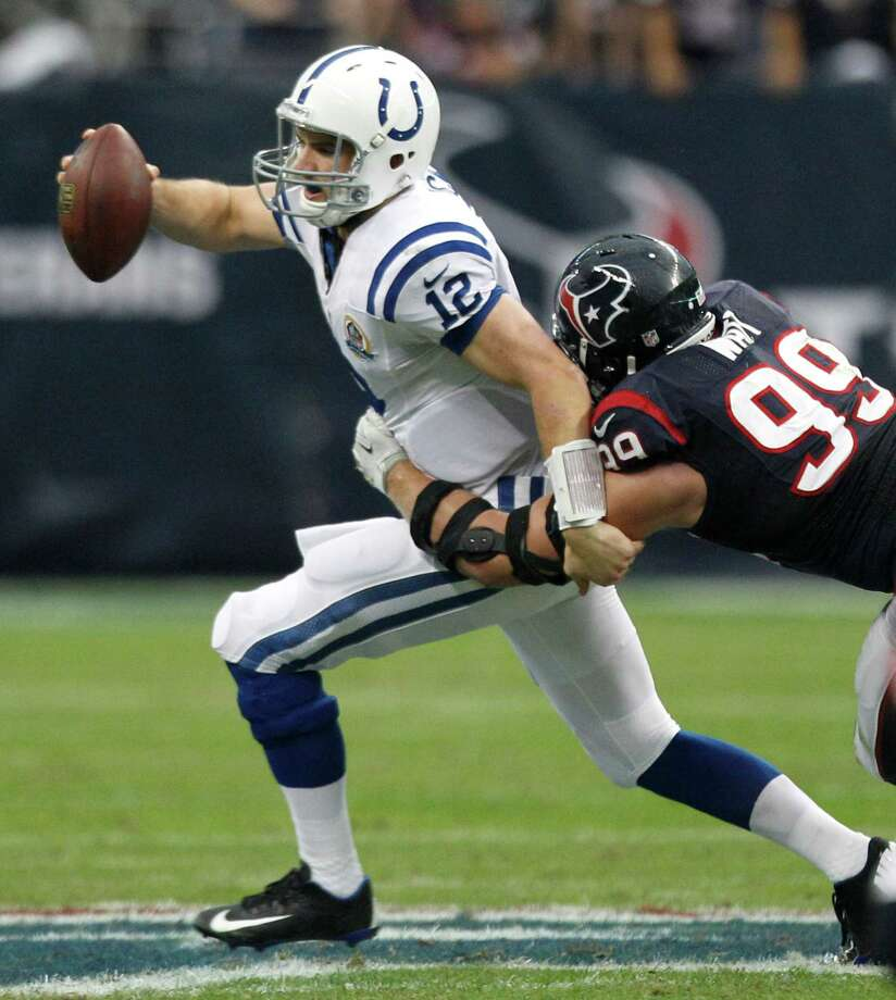 Houston Texans defensive end J.J. Watt (99) sacks Indianapolis Colts quarterback Andrew Luck (12) during the first quarter at Reliant Stadium on Sunday, Dec. 16, 2012, in Houston. ( Brett Coomer / Houston Chronicle ) Photo: Brett Coomer, Staff / © 2012  Houston Chronicle