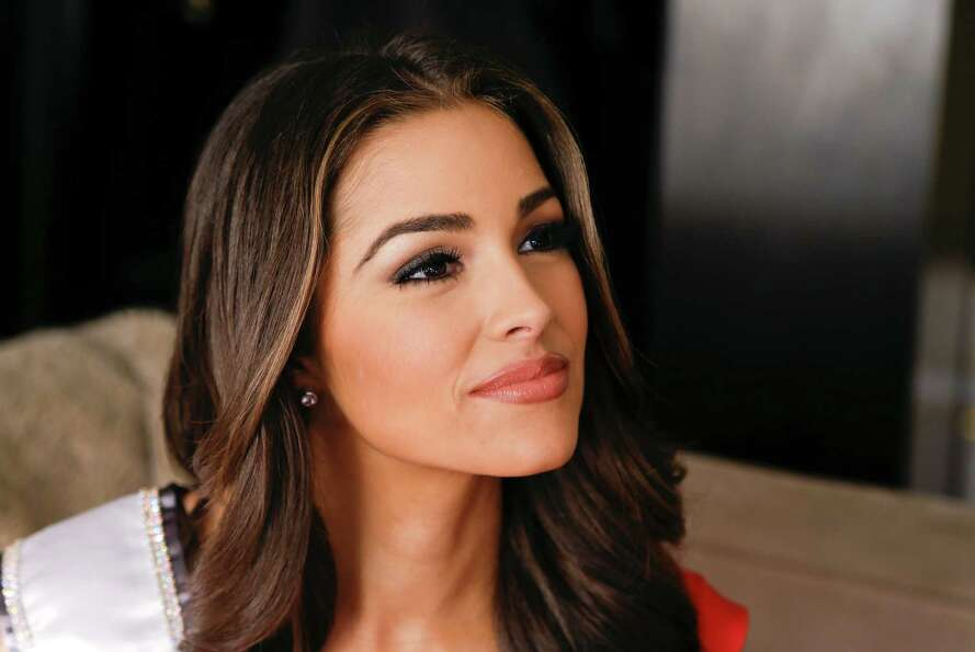 The morning after winning the Miss Universe pageant, Olivia Culpo answers questions during an interv