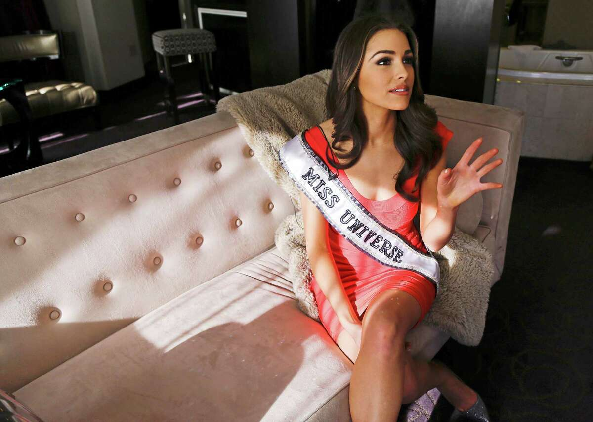 The morning after winning the Miss Universe pageant, Olivia Culpo answers questions during an interview.