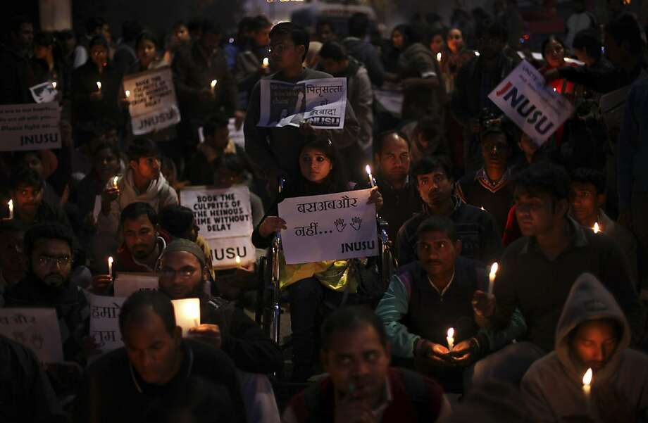 Indians participate in a candlelight vigil outside the hospital where the victim of a recent rape is being treated in New Delhi, India, Thursday, Dec. 20, 2012. The hours-long gang-rape and near-fatal beating of a 23-year-old student on a bus in New Delhi triggered outrage and anger across the country as Indians demanded action from authorities who have long ignored persistent violence and harassment against women. Photo: Altaf Qadri, Associated Press
