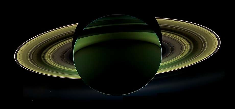 In this image provided by NASA Tuesday Dec. 18, 2012 NASA's Cassini spacecraft has delivered a glorious view of Saturn, taken while the spacecraft was in Saturn's shadow. The cameras were turned toward Saturn and the sun so that the planet and rings are backlit. In addition to the visual splendor, this special, very-high-phase viewing geometry lets scientists study ring and atmosphere phenomena not easily seen at a lower phase. Photo: Associated Press