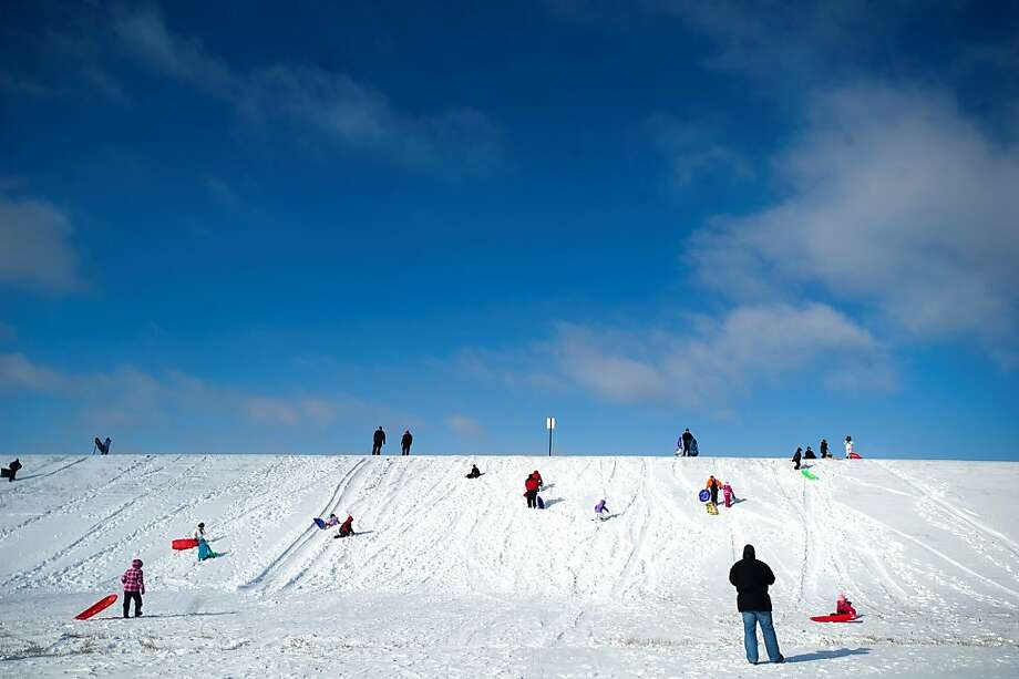 Sledders enjoy the snow on Thursday, Dec. 20, 2012 at Holmes Lake in Lincoln, Neb. Photo: Adam Wolffbrandt, Associated Press