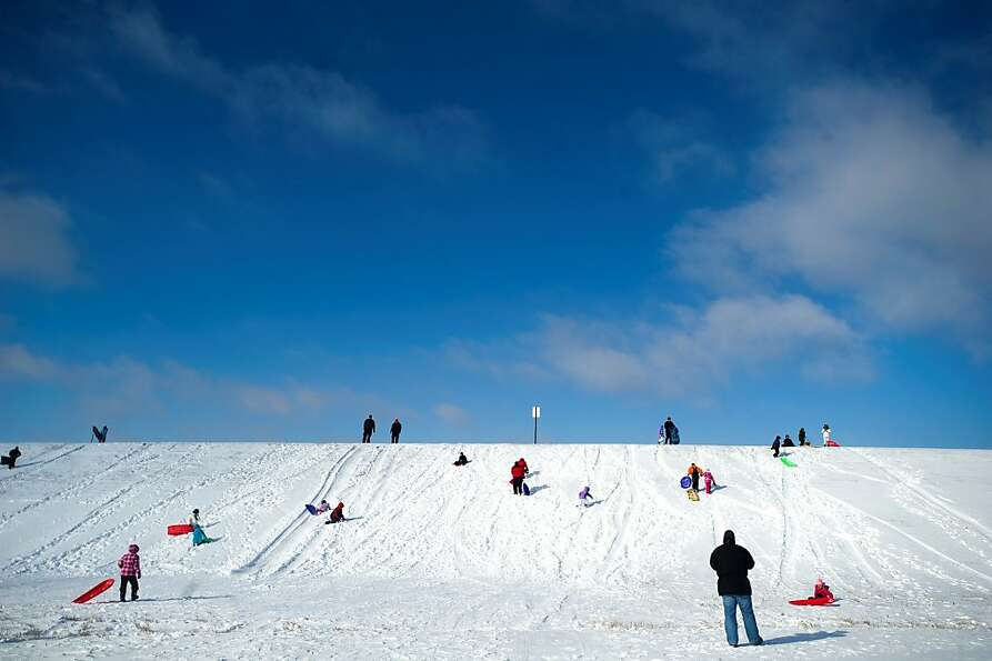 Sledders enjoy the snow on Thursday, Dec. 20, 2012 at Holmes Lake in Lincoln, Neb.