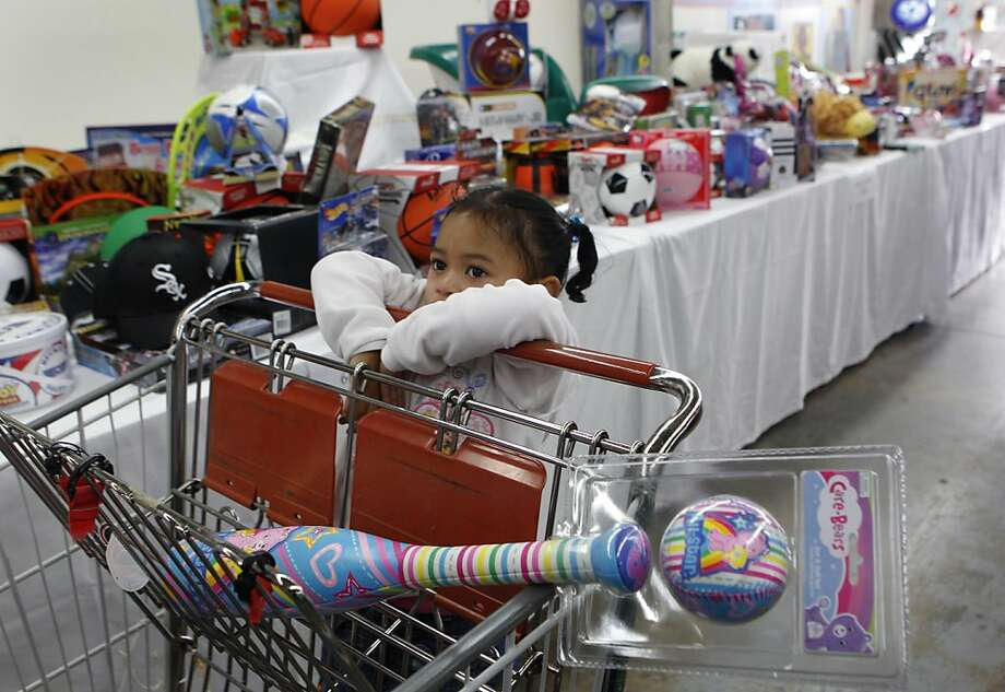 Three-year-old Dana Faga picked a Care Bears bat-and-ball set for herself at a Salvation Army holiday toy giveaway in San Francisco, Calif. on Thursday, Dec. 20, 2012. Photo: Paul Chinn, The Chronicle
