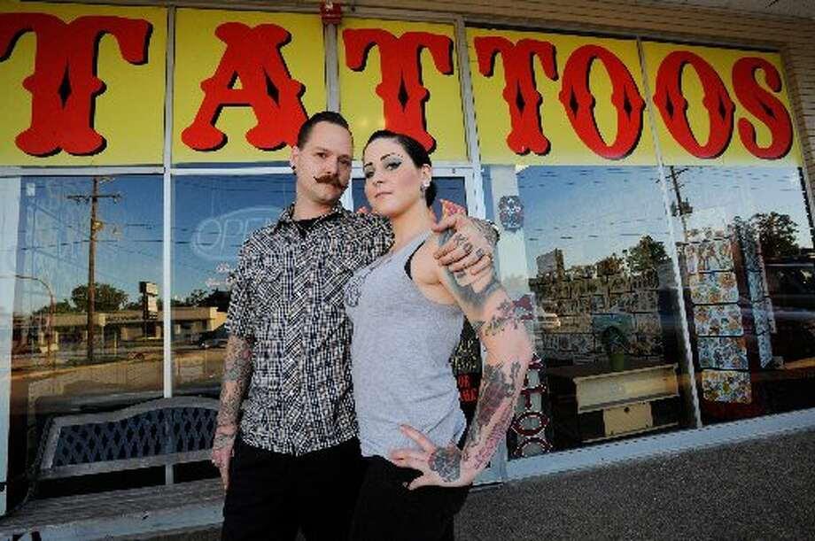 Beaumont tattoo artist Johnny Johno and his girlfriend Megan Muzerie photographed outside of Santa Fe Tattoo Parlor. Valentino Mauricio/cat5