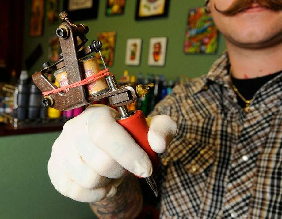Johnny Johno in his other incarnation, a tattoo artist at Santa Fe Tattoo Parlor on Calder. Valentino Mauricio/cat5