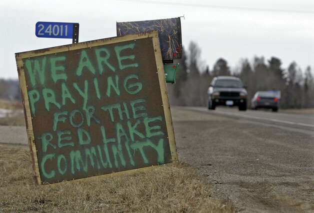 A homemade sign mourns for the community of Red Lake on the road to Red Lake on the Red Lake Indian Reservation on Wednesday, March 23, 2005. Jeff Weise, a 16-year-old student at Red Lake High School, killed nine people and then himself in the town of Red Lake on Monday.  (AP Photo/Morry Gash) Photo: MORRY GASH, ASSOCIATED PRESS / AP2005