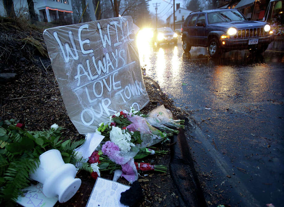 Heavy rains soaked a memorial to the shooting victims in the Sandy Hook village of Newtown, Conn., Friday, Dec. 21, 2012.   The shooter, Adam Lanza, walked into Sandy Hook Elementary School in Newtown, Dec. 14, and opened fire, killing 26 people, including 20 children, before killing himself.  Photo: AP