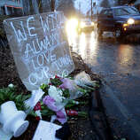 Heavy rains soaked a memorial to the shooting victims in the Sandy Hook village of Newtown, Conn., Friday, Dec. 21, 2012.   The shooter, Adam Lanza, walked into Sandy Hook Elementary School in Newtown, Dec. 14, and opened fire, killing 26 people, including 20 children, before killing himself.
