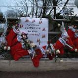 NEWTOWN, CT - DECEMBER 20:  Stockings hang at a streetside memorial for 20 children who were killed at Sandy Hook Elementary School on December 20, 2012 in Newtown, Connecticut. Six funeral services were held Thursday in the Newtown area for students and teachers slain in the attack.