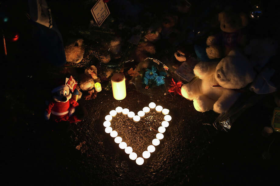 NEWTOWN, CT - DECEMBER 20:  Stuffed animals and a candle arrangement brought by morners adorn a streetside memorial on December 20, 2012 in Newtown, Connecticut. Six funeral services were held Thursday in the Newtown area for some of the 26 students and teachers slain in the attack. Photo: John Moore, Getty Images / 2012 Getty Images