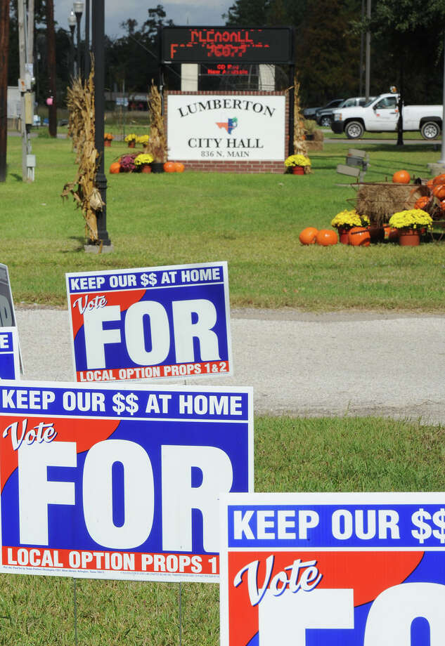 An unsigned letter was recently sent to numerous Lumberton resident's making several claims about the city's future if alcohol sales are made legal from the current election. Signs promoting the legalization of alcohol sales line the yard at Lumberton's City Hall as residents stand in queue to vote Wednesday.  Photo taken Wednesday, October 24, 2012 Guiseppe Barranco/The Enterprise Photo: Guiseppe Barranco, STAFF PHOTOGRAPHER / The Beaumont Enterprise