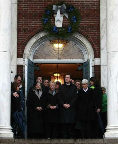 Connecticut Governor Dannel Malloy, center, Lt. Governor Nancy Wyman, to the right, and First Selectman Patricia Llodra, to the left, lead a moment of silence as a bell tolls 26 times in front of Edmond Town Hall in Newtown. The moment of silence and bell tolling was held across the state on Friday, December 21, 2012, the one week anniversary of the Sandy Hook shootings. Photo: Joshua Trujillo, Joshua Trujillo/Hearst Newspaper / News-Times
