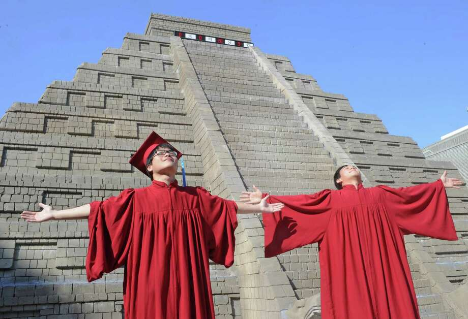 University students celebrated their graduation in front of a replica of a Mayan pyramid before a count-down ceremony organized by the National Museum of Natural Science.  (SAM YEH/AFP/Getty Images) Photo: Ap/getty