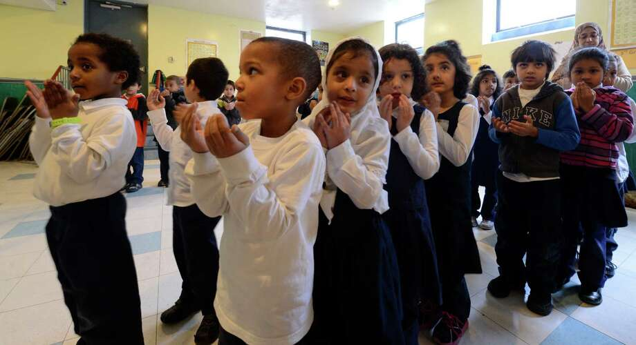 Students at the Annur Islamic School in Colonie, N.Y. observe a moment of silence Friday morning, Dec 21, 2012, in memory of the 26 victims in last Friday?s deadly shooting at Sandy Hook Elementary School in Newtown Conn. Twenty children and six teachers were fatally shot. (Skip Dickstein/Times Union) Photo: SKIP DICKSTEIN