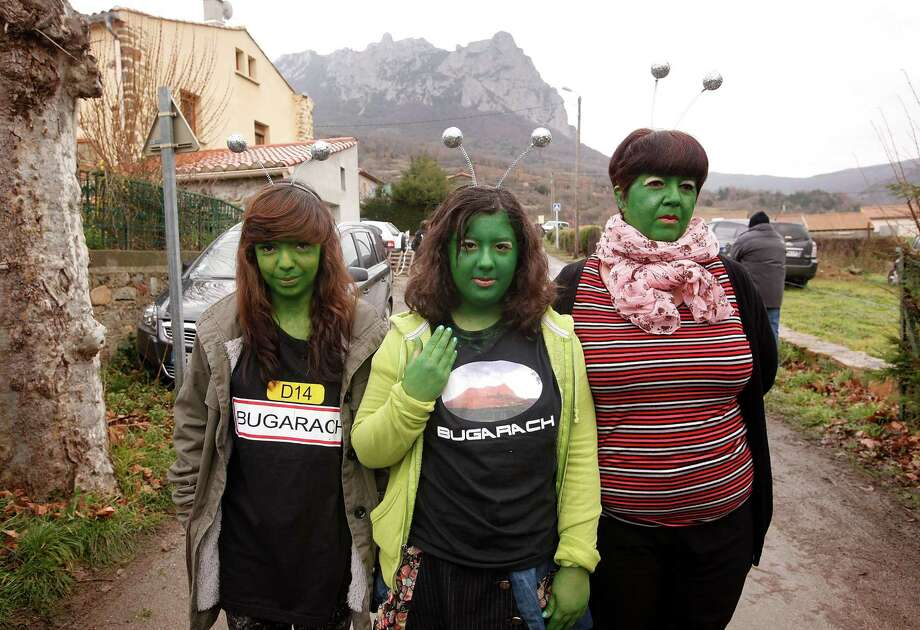 For reasons best left to the French, you had to paint your face green in Bugarach. (Photo by Patrick Aventurier/Getty Images) Photo: Patrick Aventurier, Ap/getty / 2012 Getty Images