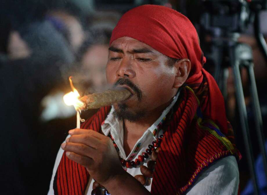 A Mayan shaman takes part in a ceremony on Friday north of Guatemala City. (JOHAN ORDONEZ/AFP/Getty Images) Photo: Ap/getty
