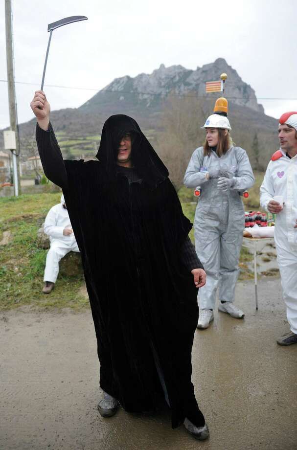 Just in case, the Reaper was ready in Bugarach. But from the look of things, more wild oats were sowed than gathered Friday. (ERIC CABANIS/AFP/Getty Images) Photo: ERIC CABANIS, Ap/getty / 2012 AFP