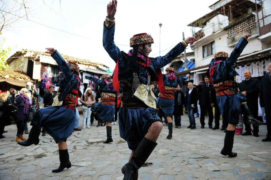 What do you do if there is no tomorrow? In the Turkish village of Sirince, you dance. Some people headed there Friday, believing it was the only safe haven from the impending apocalypse because the Virgin Mary is said to have risen to heaven from there. The village is also known for its wine. That couldn't have hurt. (BULENT KILIC/AFP/Getty Images) Photo: BULENT KILIC, Ap/getty / 2012 AFP