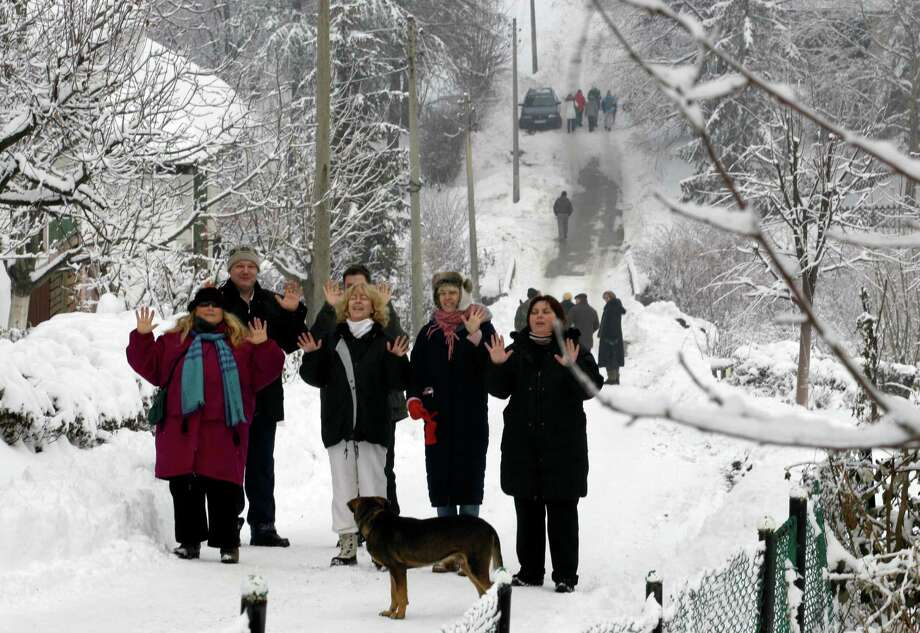 Then again, that safe place could have been in Serbia. Safe, but quite cold. People gathered at the Serbian mountain of Rtanj, 140 miles southeast of Belgrade on Friday. Mayan doomsday cultists flocked to Mount Rtanj, a pyramidal peak in Serbia, which they believed might have the power to save them. (AP Photo/Darko Vojinovic) Photo: Ap/getty