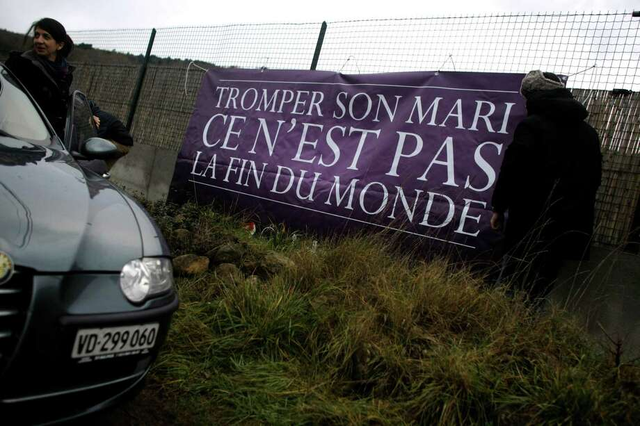 "We don't think the French and others gathered in Bugarach, France, were that worried. Someone put out this banner that reads: ""It's not the end of the world if you cheat on your husband."" (AP Photo/Marko Drobnjakovic) Photo: Ap/getty"