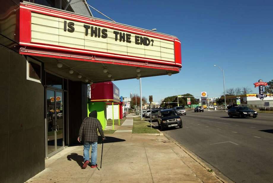 This theater in Austin, Texas, asked the question on Thursday. The answer: The show will go on. (AP Photo/Statesman.com, Jay Janner)  Photo: Ap/getty