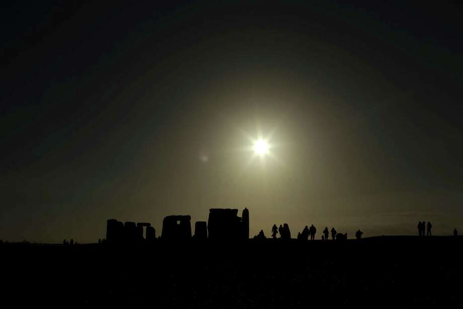 This how the day began at Stonehenge. Not the beach in Brazil, but not bad. (AP Photo/Matt Dunham) Photo: Ap/getty
