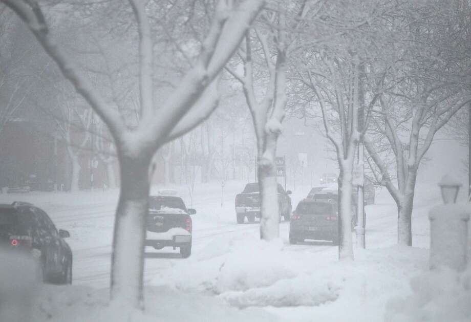 Motorists drive on East Washington Avenue towards downtown Madison, Wis., during a strong snowstorm Thursday afternoon, Dec. 20, 2012. Photo: Michael P. King, AP / Wisconsin State Journal