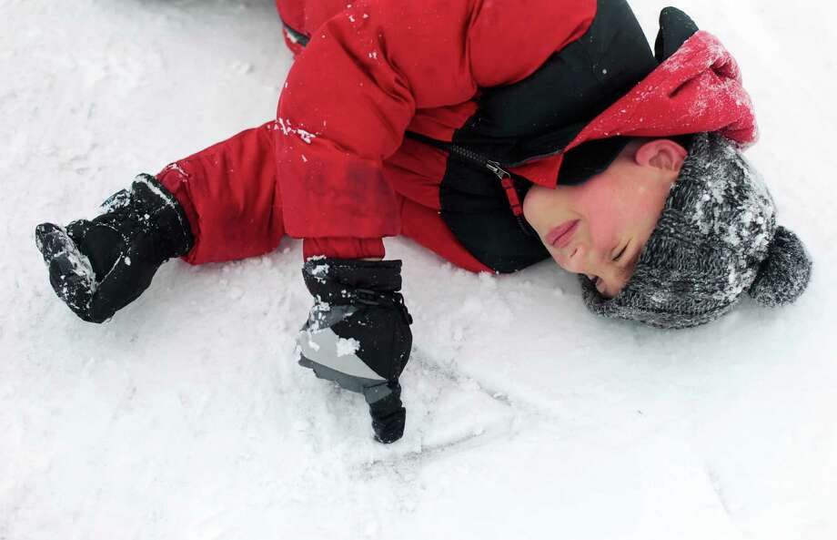 Silas Dillman, 6, draws letters in the snow while playing outside his grandparents house in Cedar Rapids, Iowa, on Thursday, Dec. 20, 2012. Photo: Kyle Grillot, AP / Cedar Rapids Gazette
