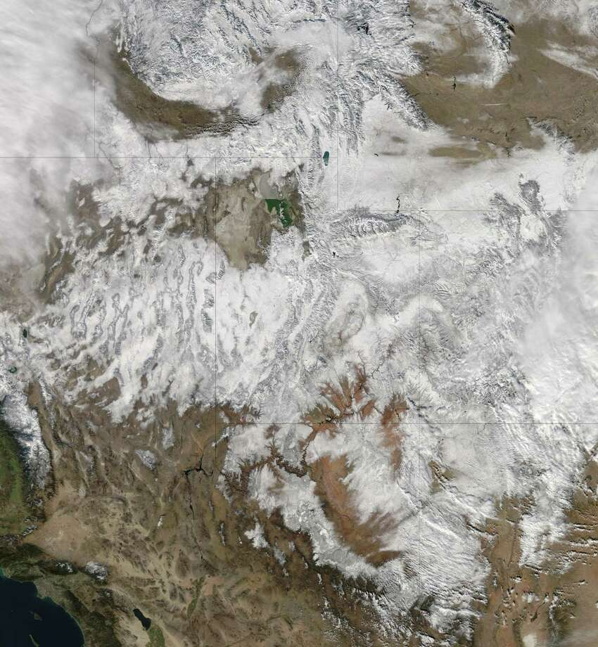 "This NASA image released on December 21, 2012 from the Moderate Resolution Imaging Spectroradiometer (MODIS) on NASA's Aqua satellite captured this natural-color image on December 19, 2012. Clouds had mostly cleared from the region, though some cloud cover lingered over parts of the US Pacific Northwest and Colorado. Showing more distinct contours than the clouds, the snow cover stretched across the Rocky Mountains and the surrounding region, from Idaho to Arizona and from California to Colorado. In time for the 2012 winter solstice, a storm dropped snow over most of the Rocky Mountains in the United States. On December 20, the National Weather Service reported snow depths exceeding 100 centimeters (39 inches) in some places—the result of the recent snowfall plus accumulation from earlier storms. = RESTRICTED TO EDITORIAL USE - MANDATORY CREDIT "" AFP PHOTO / NASA/MODIS/"" - NO MARKETING NO ADVERTISING CAMPAIGNS - DISTRIBUTED AS A SERVICE TO CLIENTS =HO/AFP/Getty Images Photo: HO, AFP/Getty Images / AFP"