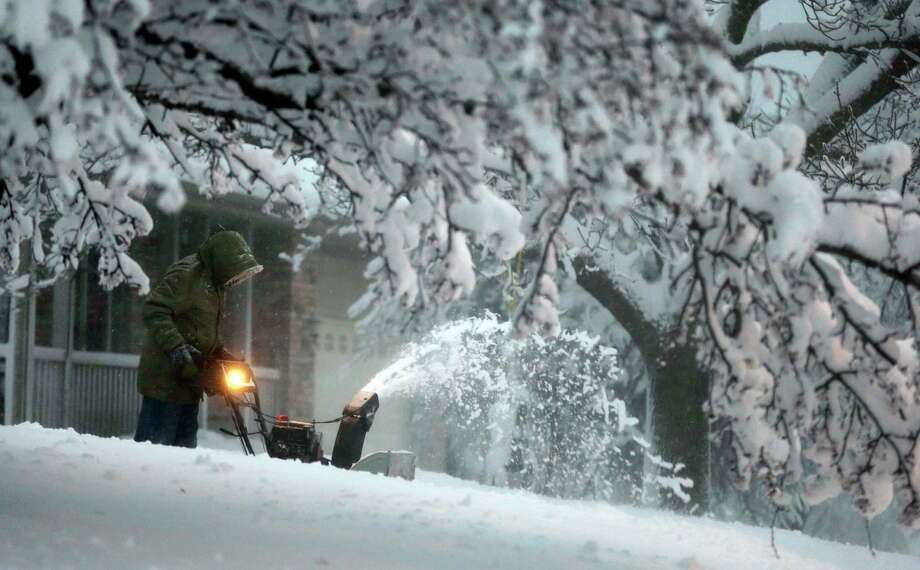 A local resident clears snow from his driveway after an overnight snowfall left many schools and businesses closed for the day, Thursday, Dec. 20, 2012, in Urbandale, Iowa. Photo: Charlie Neibergall, AP / AP