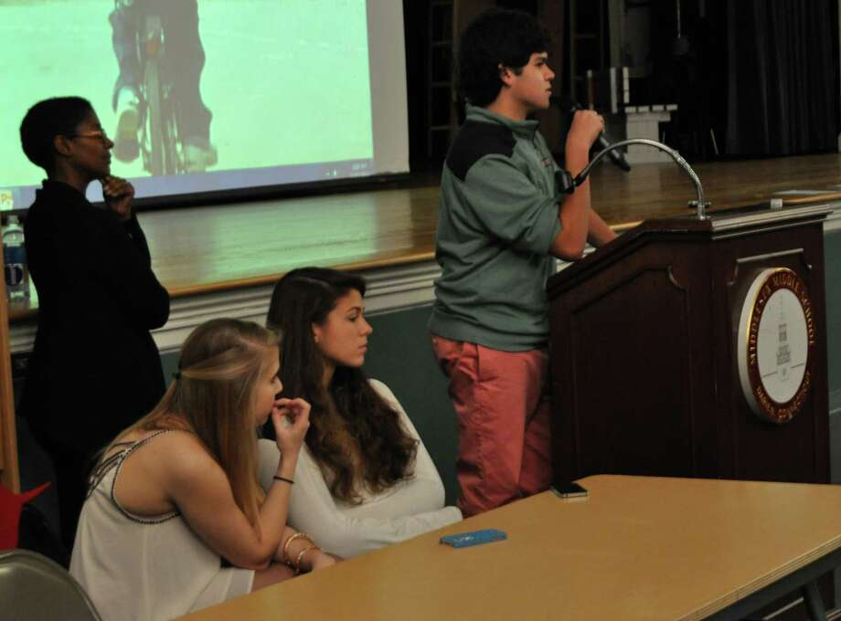 "Anti-Defamation League representative Ann-Marie Brungard, standing left, listens along with Darien High School senior Jessica Ackers, left, and junior Phoebe Taylor as senior Matt Santa explains his experiences being bullied during Middlesex Middle School's anti-bullying program ""Step Up!"" Photo: Contributed"