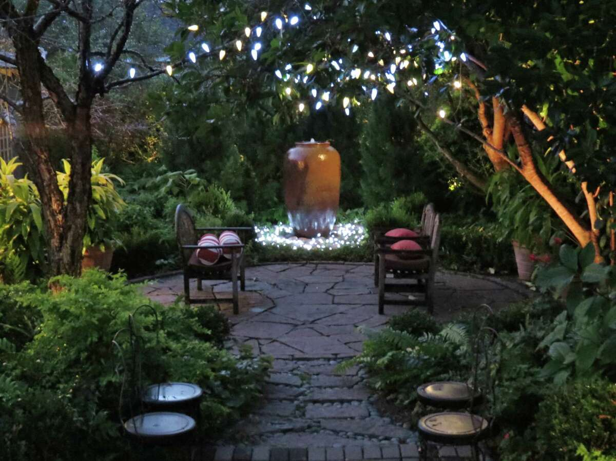 Happy holidays from the garden: David Morello's landscape is inviting day and night.