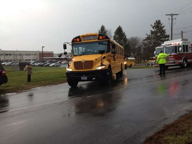 Goff Middle School in East Greenbush is evacuated after wind damage to the building on Friday, Dec. 21, 2012. (John Carl D'Annibale/Times Union)
