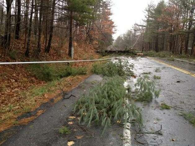 Downed wires and trees closed off part of route 66 in Averill Park by Crystal Lake Road on Friday, Dec. 21, 2012. (Lori Van Buren/Times Union)