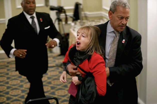 WASHINGTON, DC - DECEMBER 21:  Activist Medea Benjamin of CodePink is carried away by security guards after interrupting a National Rifle Association news conference at the Willard Hotel December 21, 2012 in Washington, DC. This is the first public appearance that leaders of the gun rights group have made since a 20-year-old man used a popular assault-style rifle to slaughter 20 school children and six adults at Sandy Hook Elementary School in Newtown, Connecticut, one week ago. Photo: Chip Somodevilla, Getty Images / 2012 Getty Images