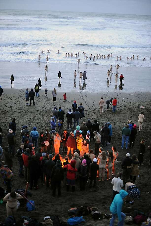 Members of the Reclaiming, a Bay Area pagan group  and others gather at Ocean Beach and enjoy a fire and dip in the water to celebrate  the winter solstice.  San Francisco, CA Thursday December 20th, 2012. Photo: Michael Short, Special To The Chronicle