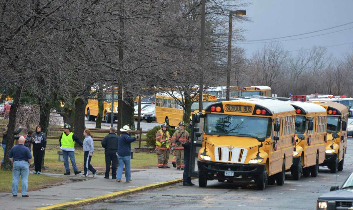 Students are evacuated from Goff Middle School in East Greenbush after a portion of the school's roof was blown off in high winds Friday morning Dec. 21, 2012. (John Carl D'Annibale / Times Union)