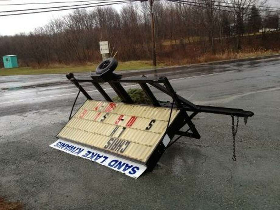 A sign was blown over by the wind near Averill Park High School on Friday, Dec. 21, 2012. (Lori Van Buren/Times Union)