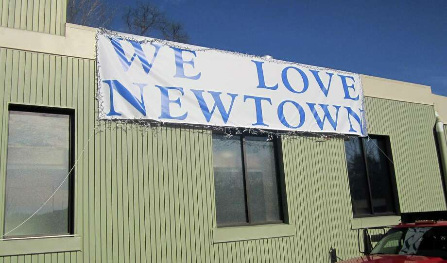 This sign is pictured Dec. 20, 2012, the day that four children and two adults killed had funerals in Newtown. Photo: Casey McNerthney/Hearst Newspapers