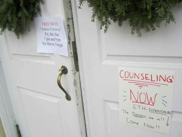 For decades, the town hall in Newtown has shown Friday night movies and the site is a popular hangout for teens. The Christmas movie scheduled for Dec. 21-23 was cancelled and grief counseling was available instead. Photo: Casey McNerthney/Hearst Newspapers