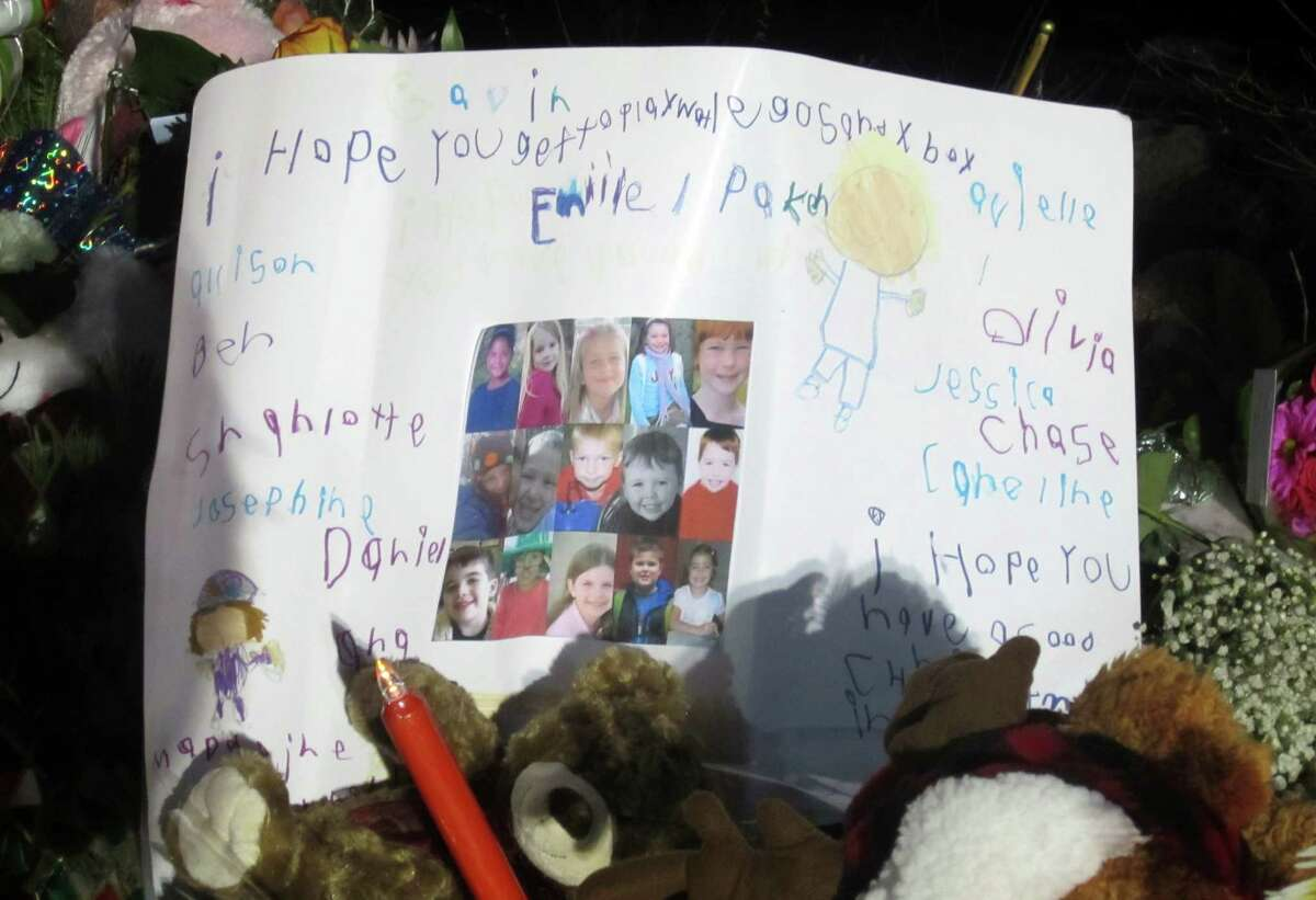 This sign from young children in Newtown was left at a huge memorial near Sandy Hook Elementary School, where 20 students and six teachers were killed Dec. 14. A child wrote that he hopes the victims get to play Legos and Xbox.